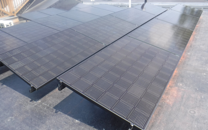 ballasted solar panels on flat roof